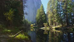El Capitan and fall trees by Merced river