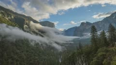 Clouds and morning mist rolling around mountains in Yosemite Valley