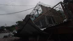 Barabise, Nepal - July 31, 2015: WS destroyed house and street