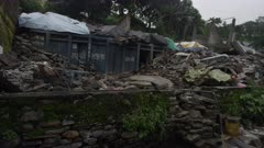 Barabise, Nepal - July 31, 2015: Huge piles of rubble in destroyed street, water pipe