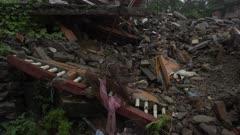 Barabise, Nepal - July 31, 2015: Tilt up piles of rubble, destroyed buildings