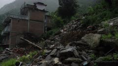 Barabise, Nepal - July 31, 2015: Street with houses turned to rubble