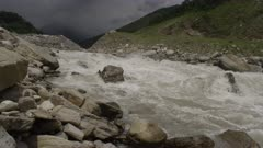 Nepal - August 1, 2015: Slow motion river rushing down hill