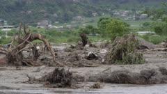 Pokhara, Nepal - August 2, 2015: Debris, stream, destruction