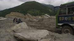 Nepal - August 1, 2015: Vehicles on makeshift road after landslide