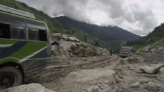 Nepal - August 1, 2015: Vehicles struggle over road after landslide