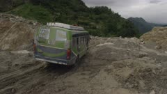 Nepal - August 1, 2015: Bus struggles over road after landslide