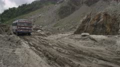 Nepal - August 1, 2015: Bus struggles over road after landslide