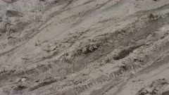 Nepal - August 1, 2015: CU motorbike on muddy road