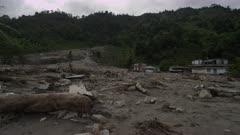 Pokhara, Nepal - August 2, 2015: Pan of landslide devastation, people