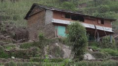 Nepal - August 3, 2015: CU house next to landslide
