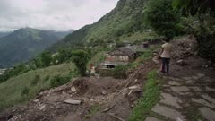 Nepal - August 3, 2015: MS path of landslide, two women, destroyed houses