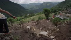 Nepal - August 3, 2015: Landslide, people walk on makeshift paths on hill