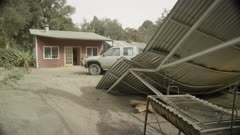 Ensenada, Chile - April 27, 2015: Pan of corrugated iron roof collapsed under volcanic ash