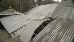 Ensenada, Chile - April 27, 2015: Corrugated iron roof collapsed under volcanic ash