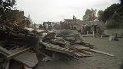 Ensenada, Chile - April 26, 2015: Destroyed house, people on roof shoveling