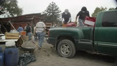 Ensenada, Chile - April 26, 2015: Tracking shot people load supplies into pick up truck