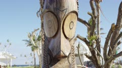 Close up on a traditional Vanuatu Slit Drum near trees uprooted by a tropical storm