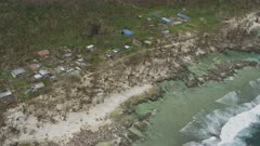Aerial view from a helicopter of the destruction left behind in the aftermath of a tropical storm
