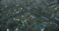 Down view over houses, suburbia, residential area with mist moving through shot, Auckland, New Zealand