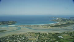 Aerial footage of Omaha Beach and coastline, New Zealand