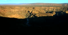 Time lapse at sun rise as the shadow moves over the  Fish River Canyon, Namibia