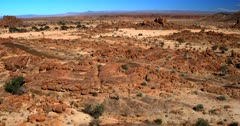 Aerial track shot across the barren Desert. Note how tiny two vehicles look in the scale of the image