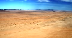 Wide aerial track across the bare Garub desert, Aus  Note the railway track that is buried in sand in places.