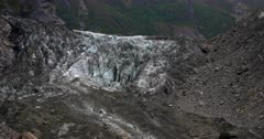 Close up Pan from Fox Glacier to the river it creates