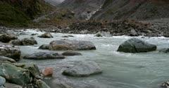 The river flowing over Glacial rocks at Fox Glacier