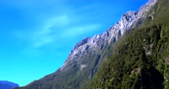 Rugged mountain tops showing a huge vertical fault line, at Milford Sound
