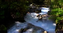 Lake Marian falls, waterfall gushing over huge rock boulders at the  Fiordland National Park