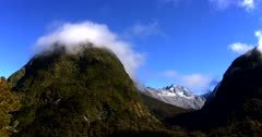 Time Lapse of Mount Cook framed by two hills with clouds passing by