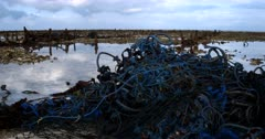 A huge pile of nets and rope left on the ocean floor from the Sea weed farmers that are no longer farming.