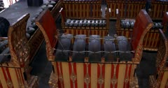 Close up shot of Huge ceremonial Singing Bowls and Xylophone instruments, at a Temple in Bali.