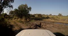 4X4 Driving on new routes next to the flooded river areas where the original sand roads lay flooded with water.