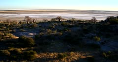 Aerial shot of Lekubu Island at sun rise, with the Makgadikgadi Pan in the surroundings.
