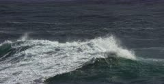 Tracking shot of a large swell breaking into a wave in Hermanus.