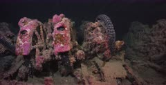 Close up shot of motor bike remains covered in growth, in the hold of the Thistlegorm Shipwreck.