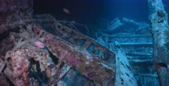 A close up shot of the wing of an aircraft, in the hold of the Thistlegorm Shipwreck with a few Soldierfish swimming around.