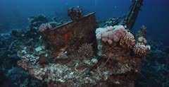 A wide shot of the Heaven One, Liveaboard shipwreck with divers on the wreck.