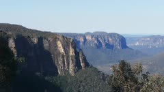 a zooming shot of pulpit rock from govetts leap in the blue mountains, australia