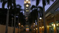 a panning shot of aloha tower in Honolulu, Oahu, North Pacific Ocean at dusk