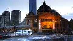 a time lapse of  melbourne's flinders street station at dusk