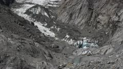 a vertical pan of the glacier at franz josef on the west coast of new zealand