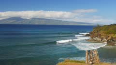 surfers ride the waves at maui's famous honolua bay