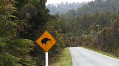 zoom in shot of a kiwi road sign on the south island of new zealand