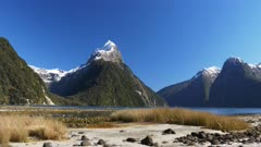a panning shot of mitre peak and milford sound