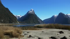a slider shot of mitre peak and milford sound in new zealand
