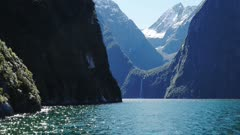 the view of sterling falls in milford sound from a cruise boat